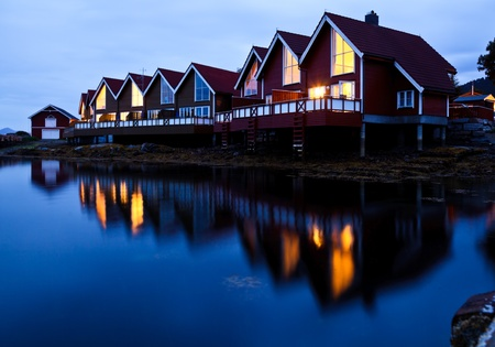 lodge: Red wooden cabins at campsite by the fjord in Molde, Norway