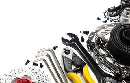 sprocket: Mountain bike tools and spares on white background Stock Photo