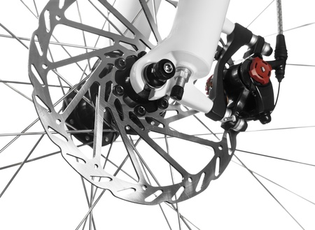 Mountain bike front wheel with mechanical disc brake on white background photo