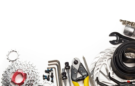 bicycle pedal: Mountain bike tools and spares on white background Stock Photo