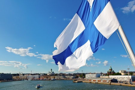 finland flag: Flag of Finland against Helsinki panorama