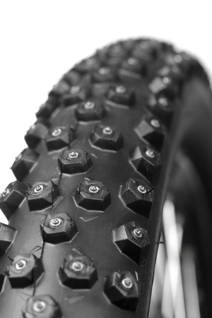 Knobby mountain bike winter tire with spikes  close-up photo