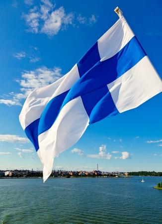 finland: Flag of Finland against Helsinki skyline