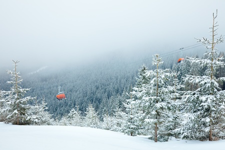 Chairlift with skiers at Jasna ski resort in Slovakia photo
