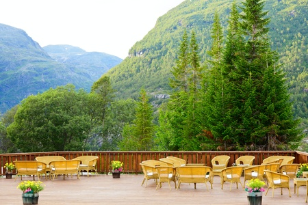 Tables and chairs of outdoor restaurant in Norway photo