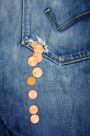 money in pocket: Money fall down from a hole in jeans pocket