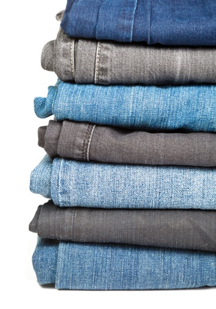 Stack of blue and black Jeans on white background Stock Photo - 12151695