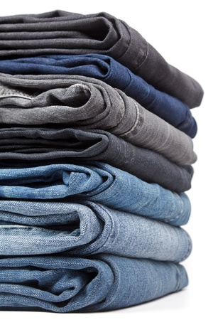 Stack of blue and black Jeans on white background Stock Photo - 12151698