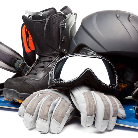 protective spectacles: Snowboard with boot helmet gloves and goggles on white background