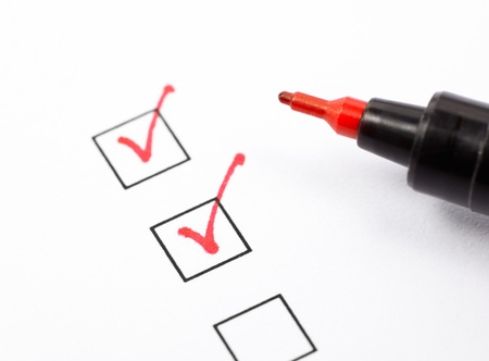 Close up shot of filled check boxes with red pen