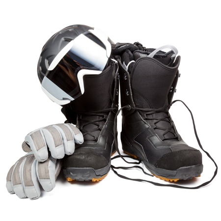 protective spectacles: Snowboard boots with helmet gloves and goggles on white background Stock Photo
