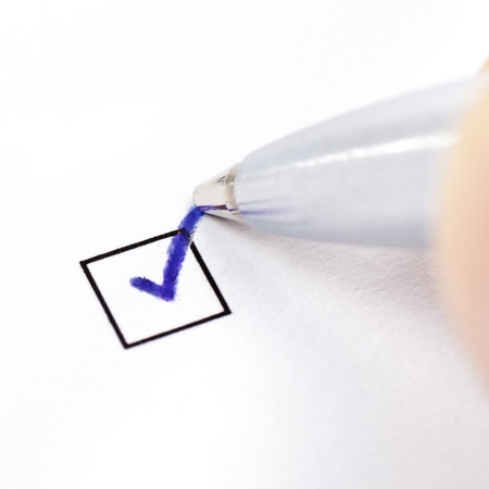 Hand with pen marking a check box Stock Photo - 12466549