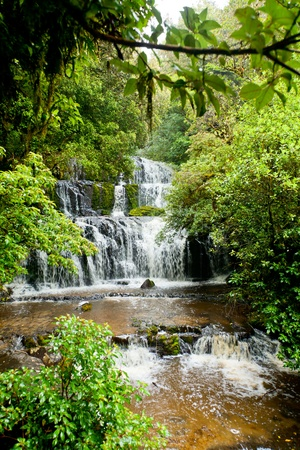 Cascading waterfall on the Purakaunui River in the South Island of New Zealand Stock Photo