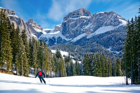 dolomites: Skier going down the slope at Val Di Fassa ski area in Italy
