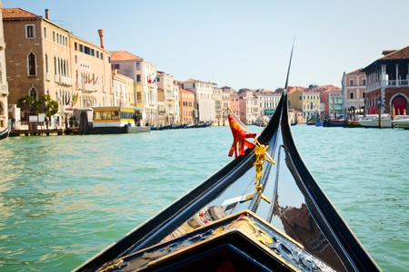 A view from gondola during the ride through the canals of Venice in Italy photo