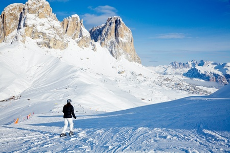 Skier going down the slope at Val Di Fassa ski resort in Italy photo