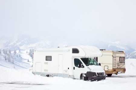 Snowed motorhomes at winter mountains photo