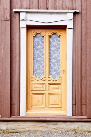 Old ornate wooden door in Norway photo