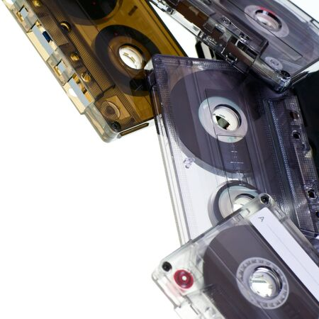 90s: Heap of Compact Cassettes on white background Stock Photo