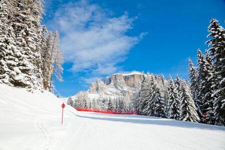 Red slope in Sella Ronda ski route, Dolomites, Italy Stock Photo - 13314279