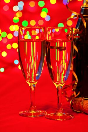 Two glasses of champagne with blured lights in background Stock Photo - 13468552