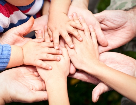 Family holding hands together closeup Stock Photo - 13468553