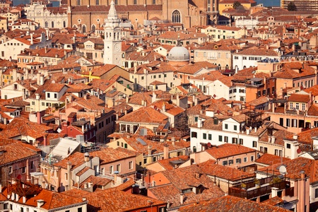 View overlooking tile rooftops in Venice, Italy photo