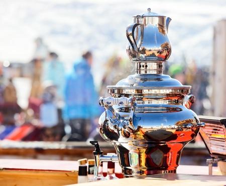 Shiny electric water boiler Samovar at Italian ski resort photo