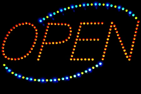 opening hours: Glowing LED Open  sign on a black background Stock Photo