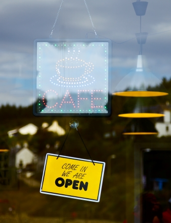 opening hours: Glowing LED Cafe sign  on a window