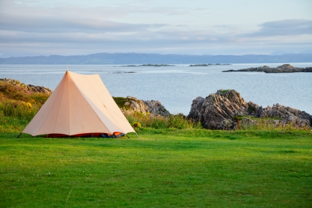 camping tent: Camping tent on a shore in a morning light