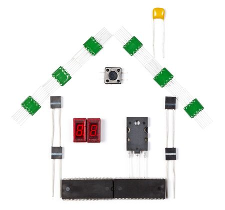 House made of electronic components on white background photo