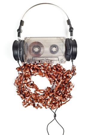 Headphones on audio cassette with pulled out tape photo