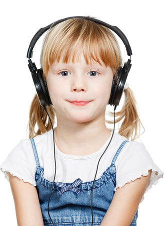 hears: Portrait of cute 4 years girl wearing headphones over a white background Stock Photo