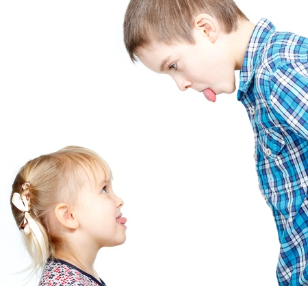 enmity: Sister and brother stick out tongues to each other