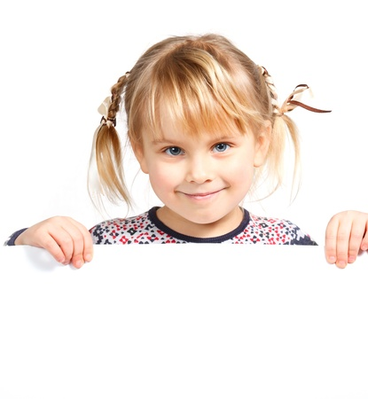 people holding sign: Cute little girl holding a white board Stock Photo