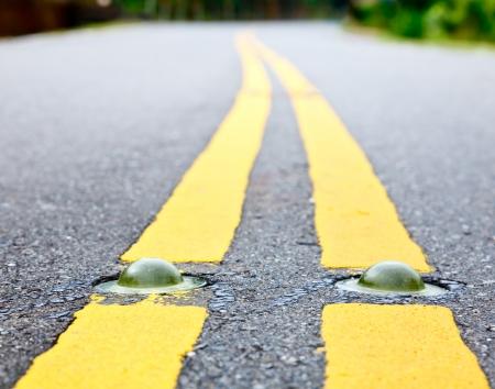 road surface: Cats eye road marking close-up