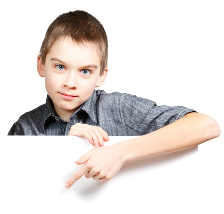 one sheet: Child pointing his finger on blank white board