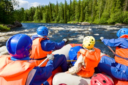 Rafters in a rafting boat on Pistojoki river in Karelia, Russia Stock Photo - 18980390
