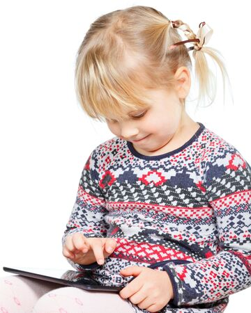 Portrait of 4 years girl  using a touch pad photo