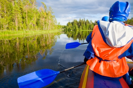 Rafters in a rafting boat on Pistojoki river in Karelia, Russia Stock Photo - 18980391