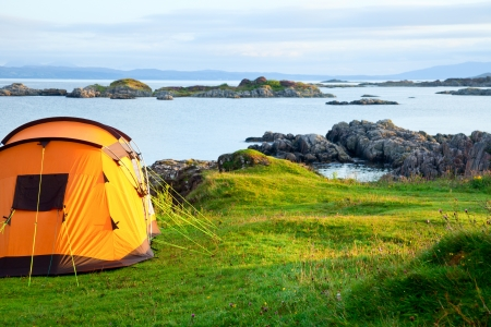 Camping tent on an ocean shore in a morning light