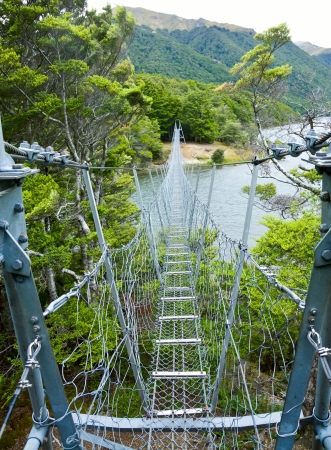 rope bridge: Swing bridge at North Mavora Lake in New Zealand Stock Photo