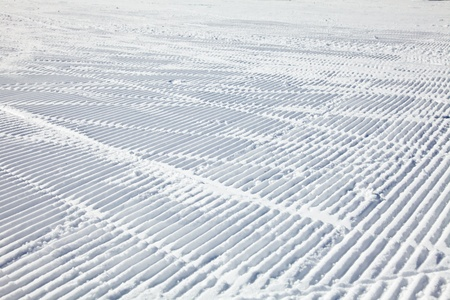 Ski tracks on a fresh groomed piste Stock Photo - 20724854