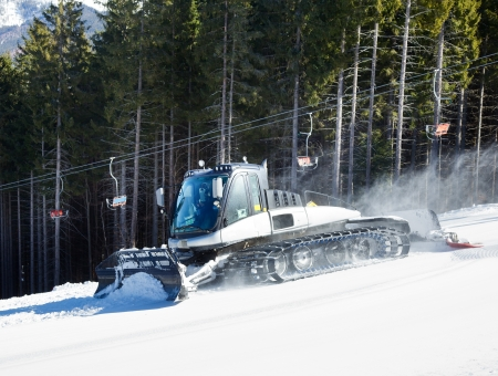 snowcat: Moving piste basher on a ski slope