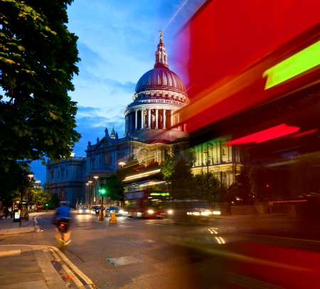 saint pauls cathedral: London cityscape with St Pauls Cathedral and moving Double Decker buses at night Stock Photo