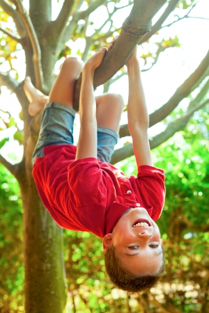 Happy boy enjoying  summer day in a garden Stock Photo - 21616460