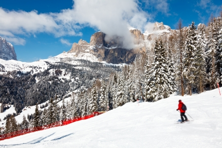 sella: Skier going down the slope at Sella Ronda ski route in Italy
