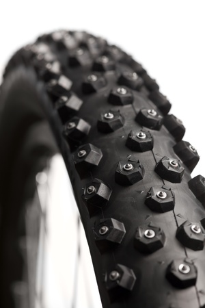 knobby: Knobby mountain bike winter tire with spikes  close-up Stock Photo