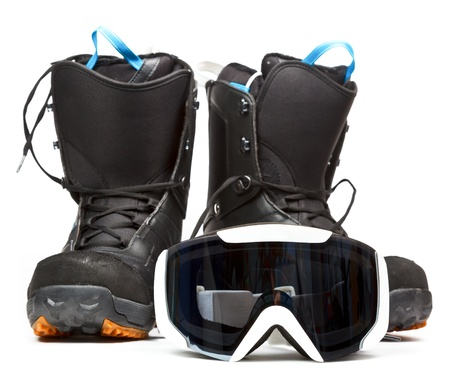protective spectacles: Snowboard mask with boots on white background
